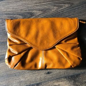 Handbags - Patent leather cognac brown clutch
